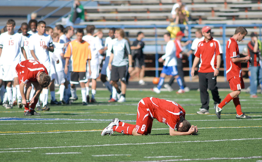Durango High School senior Dustin Geist reacts to a loss in the state semifinal prep soccer tournament.