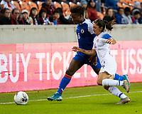 HOUSTON, TX - JANUARY 31: Melchie Dumonay #6 of Haiti and Priscila Chinchilla #14 of Costa Rica go for the ball during a game between Haiti and Costa Rica at BBVA Stadium on January 31, 2020 in Houston, Texas.