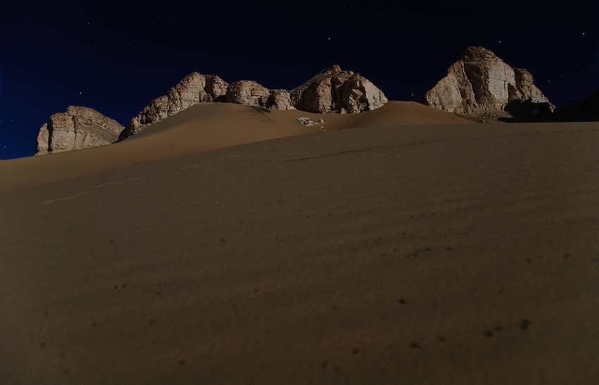 The desert plateau around Al-Qasr, Dakhla Oasis, under a full moon