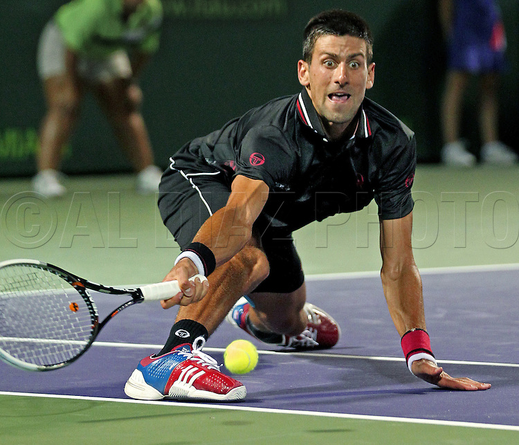 Novak Djokovic, number 1 in the world, chases a ball hit by David Ferrer, ranked 5th, during match at Sony Ericsson Open on Key Biscayne on Thursday, March 29, 2012.