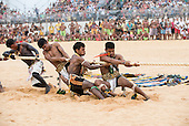 The Manoki tug of war team strains on the rope at the International Indigenous Games, in the city of Palmas, Tocantins State, Brazil. Photo © Sue Cunningham, pictures@scphotographic.com 25th October 2015