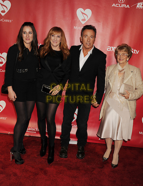 Jessica Rae Springsteen, Patti Scialfa, Bruce Springsteen and Adele Springsteen.At the 2013 MusiCares Person Of The Year at Los Angeles Convention Center in Los Angeles, California, USA,.8th February 2013..full length suit jacket tights jeans denim red pattern family married husband wife black suit white shirt  dress.CAP/ROT/TM.©Tony Michaels/Roth Stock/Capital Pictures