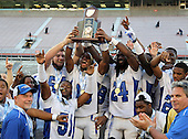 Armwood Hawks Cody Waldrop #54, Marcus Jacobs #51, Eric Striker #19, Matthew Jones #24 and others hoist the trophy after the Florida High School Athletic Association 6A Championship Game at Florida's Citrus Bowl on December 17, 2011 in Orlando, Florida.  Armwood defeated Miami Central 40-31.  (Photo By Mike Janes Photography)