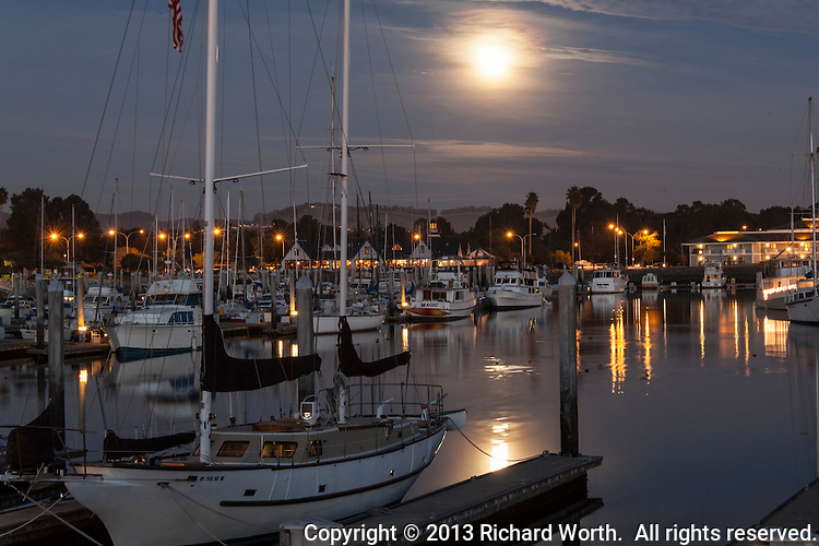 The full moon rising and reflecting in the San Leandro Marina.  The December 2013 full moon is known in Native American lore as the Full Cold Moon.