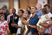 United States President Barack Obama and First Lady Michelle Obama, with daughters Sasha and Malia, attend Christmas services at the Marine Corp Base Hawaii chapel in Kaneohe Bay, Hawaii, Sunday, December 25, 2011. .Mandatory Credit: Pete Souza - White House via CNP