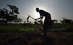 Martha Yar uses a hoe to prepare the ground for planting at the Multi Agricultural Jesuit Institute of Sudan (MAJIS), an agricultural school located outside Rumbek, South Sudan.