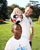 "Ben Olsen and friend during a  D.C United clinic in support of first lady Michelle Obama's ""Let's Move"" initiative on the White House lawn, in Washington D.C. on October 7 2010."