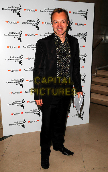 "GRAHAM NORTON.The ""Figures of Speech"" fundraising gala, Royal Horticultural Halls, London, England..February 27th, 2008.full length black suit polka dot shirt.CAP/CAN.©Can Nguyen/Capital Pictures."