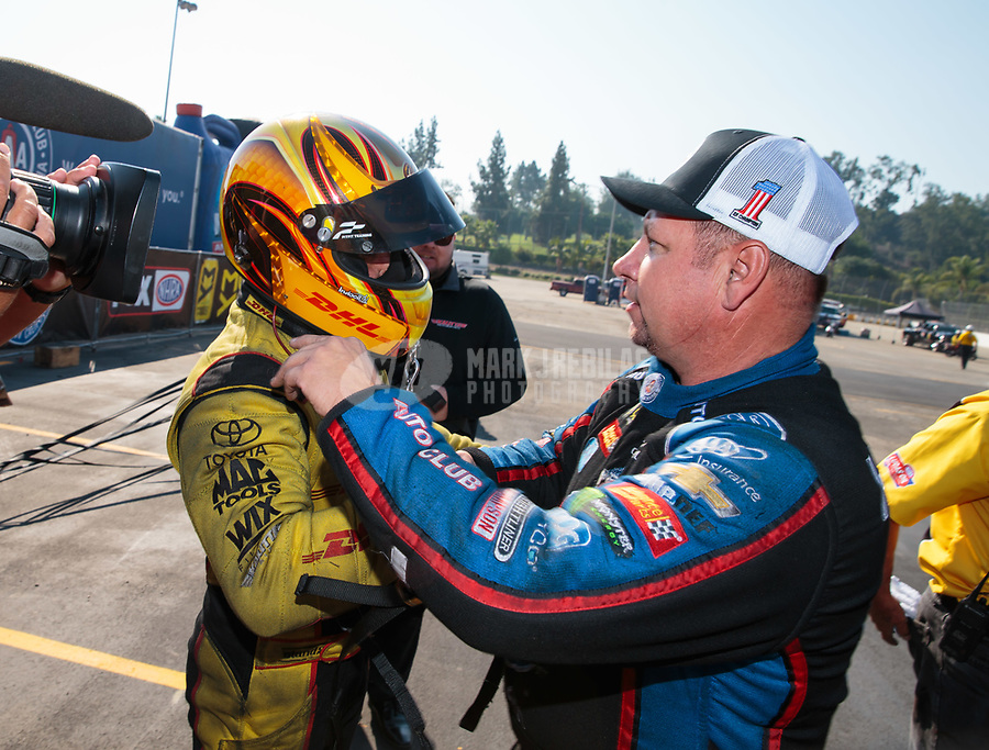 Nov 11, 2018; Pomona, CA, USA; NHRA funny car driver J.R. Todd (left) is congratulated by Robert Hight after clinching the 2018 funny car world championship during the Auto Club Finals at Auto Club Raceway. Mandatory Credit: Mark J. Rebilas-USA TODAY Sports
