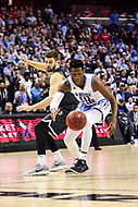 Washington, DC - MAR 11, 2018: Rhode Island Rams forward Cyril Langevine (10) steals the ball from Davidson Wildcats forward Will Magarity (22) during the Atlantic 10 men's basketball championship between Davidson and Rhode Island at the Capital One Arena in Washington, DC. (Photo by Phil Peters/Media Images International)