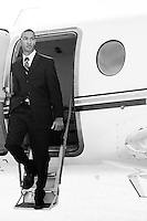 Fashion Business Commercial Shot of young professional exiting private plane
