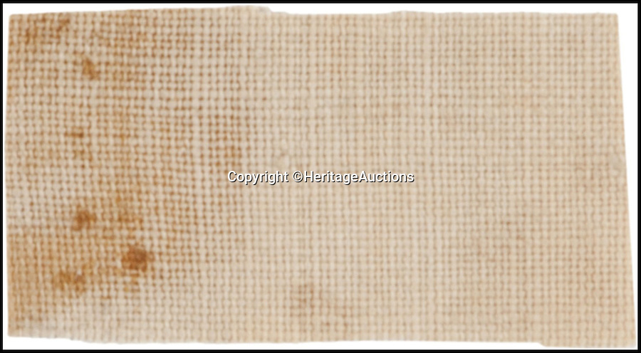 BNPS.co.uk (01202 558833)<br /> Pic: HeritageAuctions/BNPS<br /> <br /> A piece of bloodstained linen from the sheet that President Lincoln died on.<br /> <br /> Gruesome souvenirs taken following Abraham Lincoln's assassination are set to be sold at a macabre auction in the US. <br /> <br /> A blood stained towel used to bind the president's wound moments after he was gunned down in Ford's theatre by actor John Wilkes Booth, as well as locks of both men's hair are among a set of grim lots tipped to fetch tens of thousands of pounds.<br /> <br /> It was in April 1865 that Booth burst into the civil war leader's private box during a performance of Our American Cousin, which was being watched by an audience of 1,500, and fired into Lincoln's head at point blank range. <br /> <br /> And 151 years later some of the more unusual remnants from that fateful night and its immediate aftermath will be sold by Heritage Auctions on September 17.
