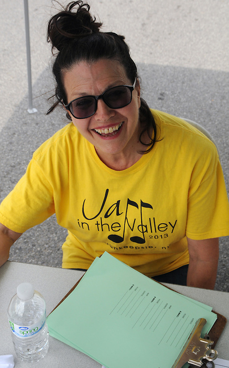 Nancy Cozean, is among the many volunteers workers at the 2014 Jazz in the Valley Festival held in Waryas Park on the Hudson River front in Poughkeepsie, NY on Sunday August 17, 2014. Photo by Jim Peppler. Copyright Jim Peppler 2014 all rights reserved.