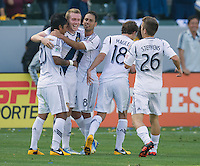 CARSON, CA - March 17, 2013: LA Galaxy forward Jack McBean (32) and his teammates celebrates his goal during the LA Galaxy vs Chivas USA game at the Home Depot Center in Carson, California. Final score LA Galaxy 1, Chivas USA 1.