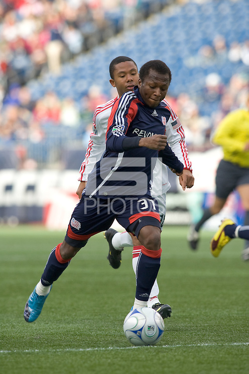 New England Revolution midfielder Sainey Nyassi (31) dribbles as Chicago Fire midfielder Mike Banner (18) defends. The New England Revolution out scored the Chicago Fire, 2-1, in Game 1 of the Eastern Conference Semifinal Series at Gillette Stadium on November 1, 2009.