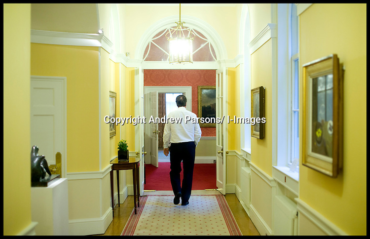 The Prime Minister David Cameron walks back to his office inside Number 10 Downing street, Thursday May 13, 2010.  Photo By Andrew Parsons/i-Images