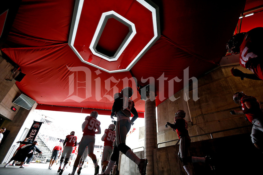 Ohio State Buckeyes make their way out for final warmups  before their game against Western Michigan Broncos at Ohio Stadium on September 26, 2015.  (Dispatch photo by Kyle Robertson)