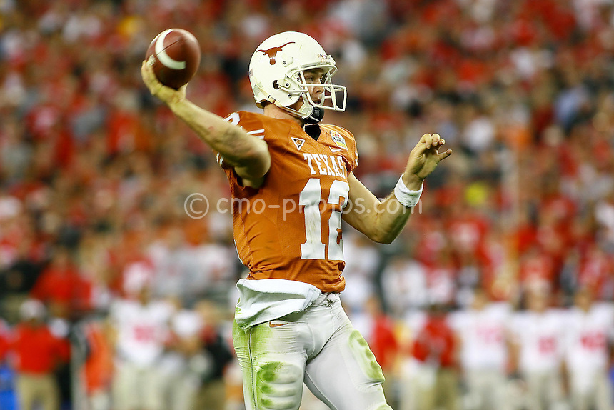 Jan 05, 2009; Glendale, AZ, USA; Texas Longhorns quarterback Colt McCoy (12) throws the ball in the second half of the Fiesta Bowl against the Ohio State Buckeyes at University of Phoenix Stadium.  The Longhorns won the game 24-21.