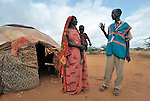Mohammed Haibe (right) is a Community Peace and Security Team member in the Ifo Camp, part of the Dadaab refugee complex in northeastern Kenya. here he talks with Faduma Absher Tuko. The CPSTs, coordinated by the ACT Alliance, provide self-policing in the camps. They team members are all refugees and volunteers. The Lutheran World Federation, a member of the ACT Alliance, is camp manager for the Dadaab complex, essentially the world's largest refugee camp.