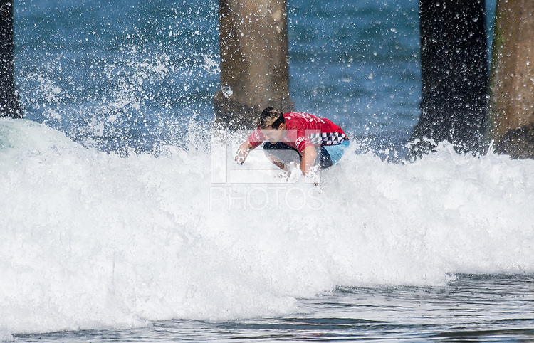 Huntington Beach, CA - Tuesday July 31, 2018: Italo Ferreira in action during a World Surf League (WSL) Qualifying Series (QS) Men's round of 96 heat at the 2018 Vans U.S. Open of Surfing on South side of the Huntington Beach pier.