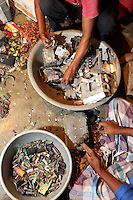 People sift through used electronics in a village near Kolkata which recycle e-waste.<br />