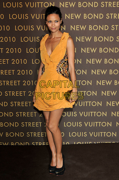 THANDIE NEWTON .attends the launch of the Louis Vuitton Bond Street Maison in London, England, UK, May 25th, 2010..full length yellow dress platform black shoes clutch bag orange sleeveless .CAP/PL.©Phil Loftus/Capital Pictures.