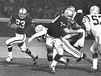 Raiders Charlie Smith #23 running with blocking from #70 Jim Harvey against the Colts. (1969 photo by Ron Riesterer)