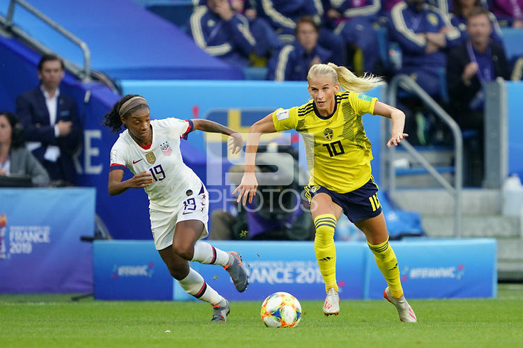 LE HAVRE, FRANCE - JUNE 20: Crystal Dunn #19, Sofia Jakobsson #10 during a 2019 FIFA Women's World Cup France group F match between the United States and Sweden at Stade Océane on June 20, 2019 in Le Havre, France.