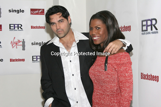 Dr. Reef Karim  &amp; Omarosa Manigault-Stallworth<br />The Winter LA Celebrity Charity Event to honor Sound Art and Black Sheep<br />Private Residence<br />West Hollywood, CA, USA<br />Sunday, December 05th, 2004<br />Photo By Celebrityvibe.com/Photovibe.com, <br />New York, USA, Phone 212 410 5354, <br />email: sales@celebrityvibe.com
