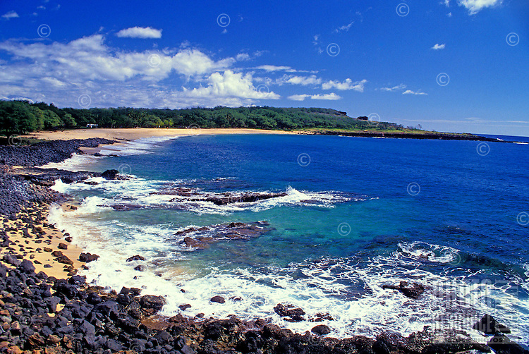 Rocky shoreline with the beautiful blue Pacific Ocean at Manele Bay on the sparsely populated island of Lanai.
