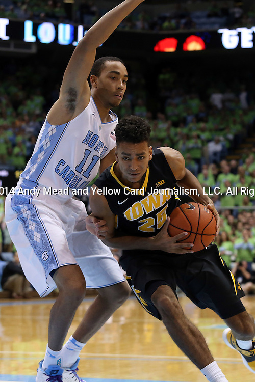 03 December 2014: Iowa's Dom Uhl (GER) (25) and North Carolina's Brice Johnson (11). The University of North Carolina Tar Heels played the University of Iowa Hawkeyes in an NCAA Division I Men's basketball game at the Dean E. Smith Center in Chapel Hill, North Carolina. Iowa won the game 60-55.