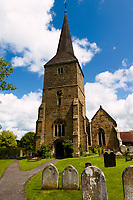 St. Mary's Church, Hartfield Village, near Ashdown Forest, Sussex, UK, May 20, 2017. Picturesque Ashdown Forest stretches across the countries of Surrey, Sussex and Kent, and is the largest open access space in the South East of England. It is famous as the geographical inspiration for the Winnie the Pooh stories and is popular with fans of the characters.