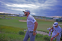 Dustin Johnson (USA) walks off the 18th green as a co leader during the first round of the 118th U.S. Open Championship at Shinnecock Hills Golf Club in Southampton, NY, USA. 14th June 2018.<br /> Picture: Golffile | Brian Spurlock<br /> <br /> <br /> All photo usage must carry mandatory copyright credit (&copy; Golffile | Brian Spurlock)