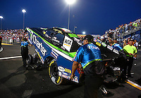 Sep 27, 2013; Madison, IL, USA; NHRA funny car driver Tony Pedregon is pushed toward the water box by crew members during qualifying for the Midwest Nationals at Gateway Motorsports Park. Mandatory Credit: Mark J. Rebilas-