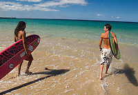 Surfers at Hapuna Beach on the Big Island of Hawaii