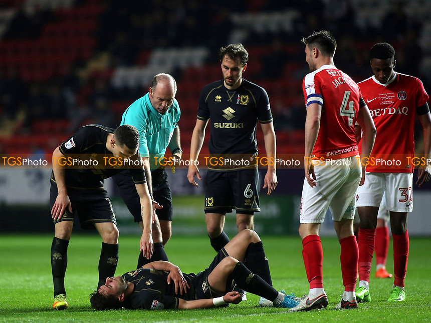 George Baldock of MK Dons lies on the ground after a tackle during Charlton Athletic vs MK Dons, Sky Bet EFL League 1 Football at The Valley on 4th April 2017