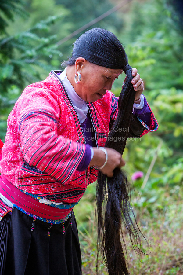 Longji, China.  Woman of Yao Ethnic Minority Showing her Long Hair.