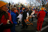 A woman is evacuated by members of the New York City Police department before the 89th Macy's Thanksgiving Annual Day Parade in the Manhattan borough of New York.  11/26/2015. Eduardo MunozAlvarez/VIEWpress