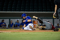 AZL Cubs third baseman Cam Balego (82) upends opposing catcher Zachery Almond on a slide into home plate during the game against the AZL Diamondbacks on August 11, 2017 at Sloan Park in Mesa, Arizona. AZL Cubs defeated the AZL Diamondbacks 7-3. (Zachary Lucy/Four Seam Images)