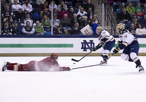 January 25, 2013:  Notre Dame center T.J. Tynan (18) skates with the puck alongside Notre Dame center Thomas DiPauli (14) as Ferris State defenseman Jason Binkley (7) defends during NCAA Hockey game action between the Notre Dame Fighting Irish and the Ferris State Bulldogs at Compton Family Ice Arena in South Bend, Indiana.  Ferris State defeated Notre Dame 3-1.