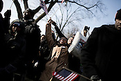 January 20, 2009. Washington, DC..Almost 2 million people packed the National Mall in sub freezing temperatures to witness the swearing in of Barack Obama, the 44th president of the united States and the first African American to hold the office.  .The crowd went wild as the president-elect was introduced.