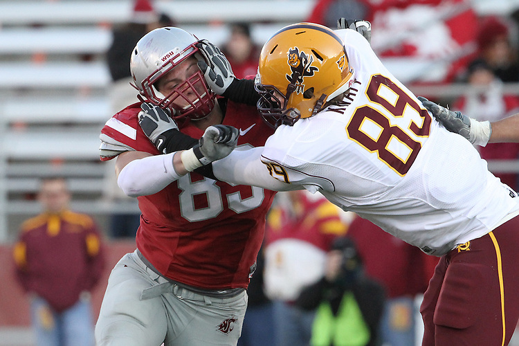 Travis Long (#89 in crimson), Washington State freshman defensive end, locks up with an Arizona State player during the Cougars Pac-10 conference football game at Martin Stadium in Pullman, Washington, on October 10, 2009.