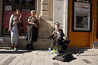 Busker playing the clarinet on Istiklal Caddesi, Istanbul, Turkey. Formerly Rue de Pera it is in the centre of the city's old historical European quarter