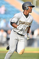 Charleston RiverDogs center fielder Josh Stowers (21) rounds first base during game one of a double header against the Asheville Tourists at McCormick Field on April 9, 2019 in Asheville, North Carolina. The Tourists defeated the RiverDogs 17-3. (Tony Farlow/Four Seam Images)
