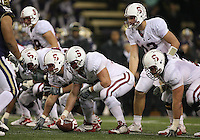 Oct 30, 20010:  Stanford quarterback #12 Andrew Luck sets up under center Chase Beeler against Washington.  Stanford defeated Washington 41-0 at Husky Stadium in Seattle, Washington...