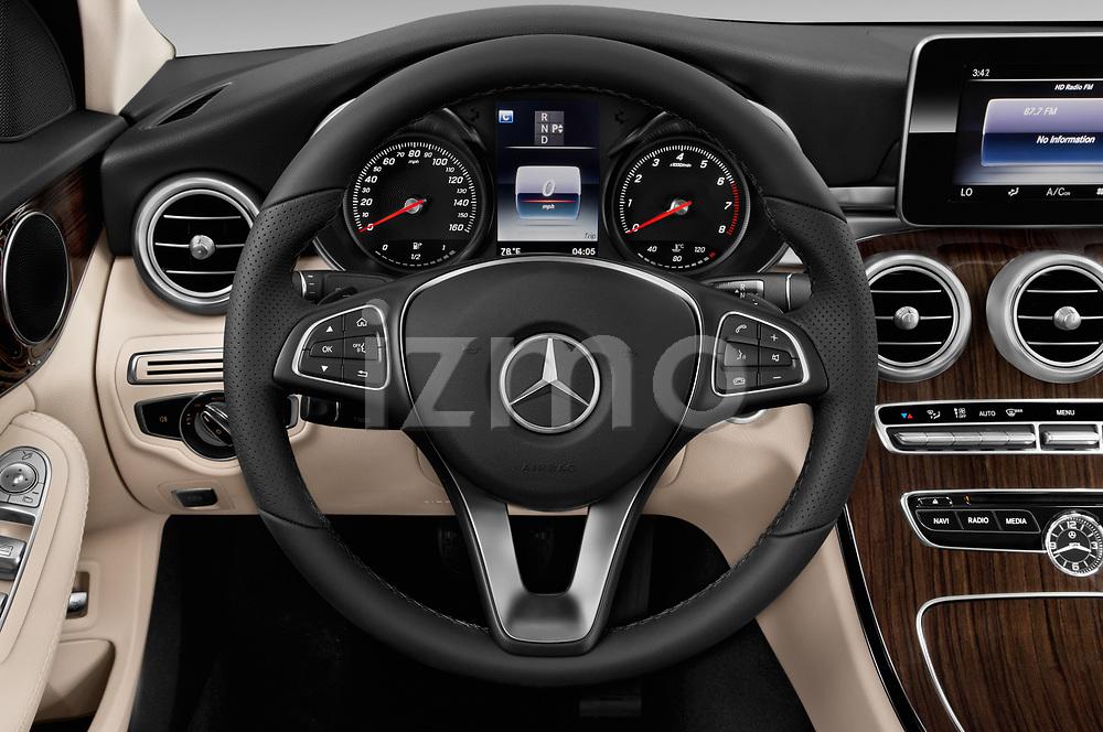 Car pictures of steering wheel view of a 2017 Mercedes Benz C Class 300 4 Door Sedan