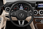 Car pictures of steering wheel view of a 2017 Mercedes Benz C Class 300 4 Door Sedan