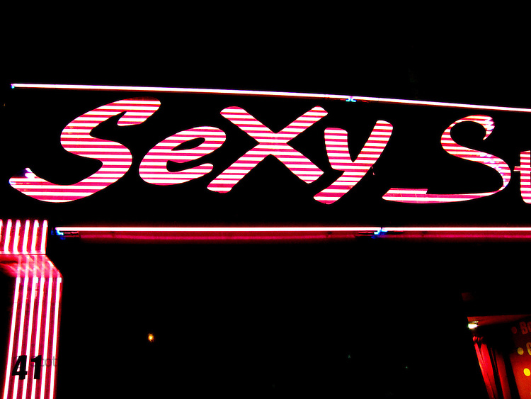 Close-up of neon lights at night of the Paris Sex Shops in Montmarte, Paris, France