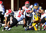 BROOKINGS, SD - OCTOBER 25:  Zach Zenner #31 from South Dakota State University looks to make a move against Tre' Moore #2 from Youngstown State in the second quarter of their game Saturday afternoon at Coughlin Alumni Stadium in Brookings. (Photo by Dave Eggen/Inertia)