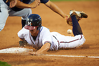 Mississippi Braves outfielder KD Kang (12) slides into third during a game against the Pensacola Blue Wahoos on May 27, 2015 at Trustmark Park in Pearl, Mississippi.  Pensacola defeated Mississippi 7-5 in fourteen innings.  (Mike Janes/Four Seam Images)